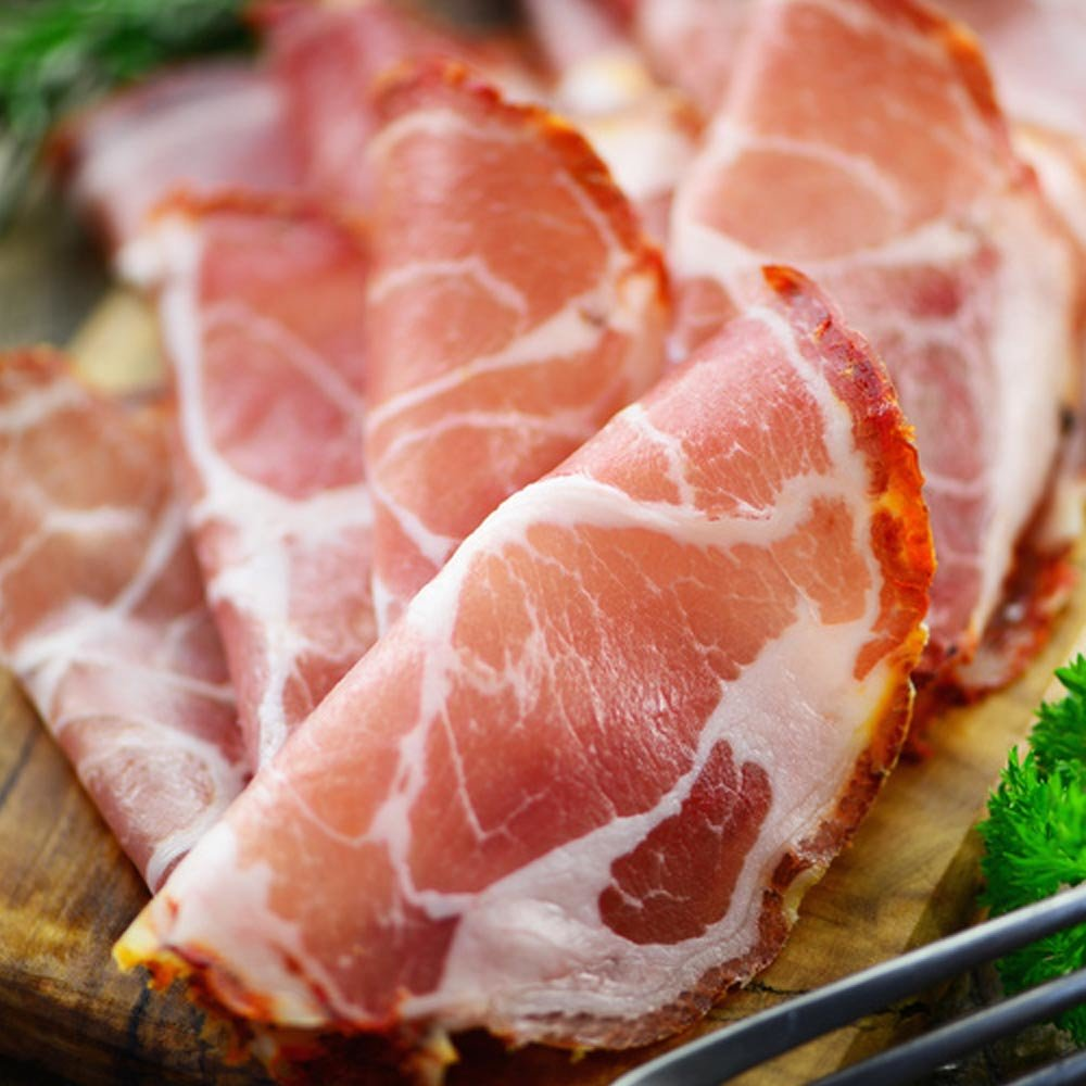 Capocollo di suino nero geschnitten Capocollo vom schwarzen Schwein